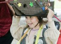 Lucian Heydt-Moorash, 4 of Bethel, tries on a ship hat at the Bethel Historical Society's birthday bash to honor P.T. Barnum, held on the Bethel Public Library lawn. Sunday, July 5, 2015