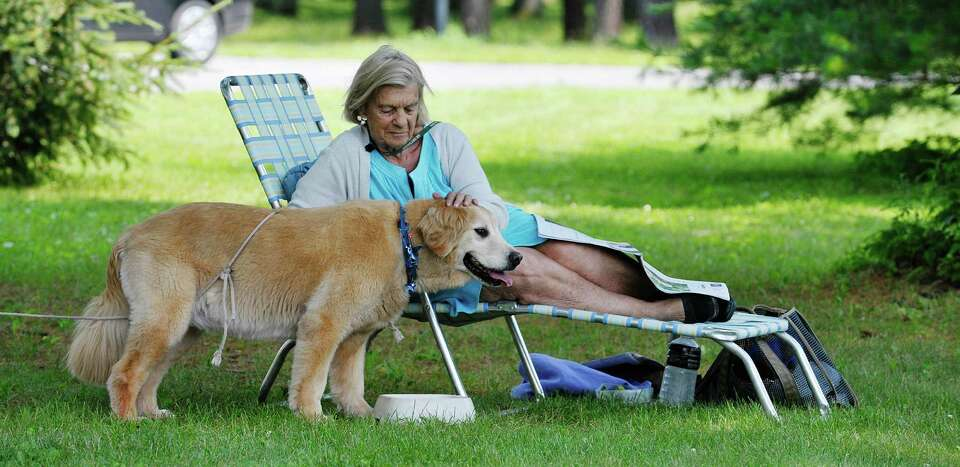 Carol Dziamba of Colonie enjoys a morning in Saratoga Spa State Park with her dog Jasmine Rose on Su