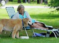Carol Dziamba of Colonie enjoys a morning in Saratoga Spa State Park with her dog Jasmine Rose on Sunday, July 5, 2015, in Saratoga Springs, N.Y.  (Paul Buckowski / Times Union)