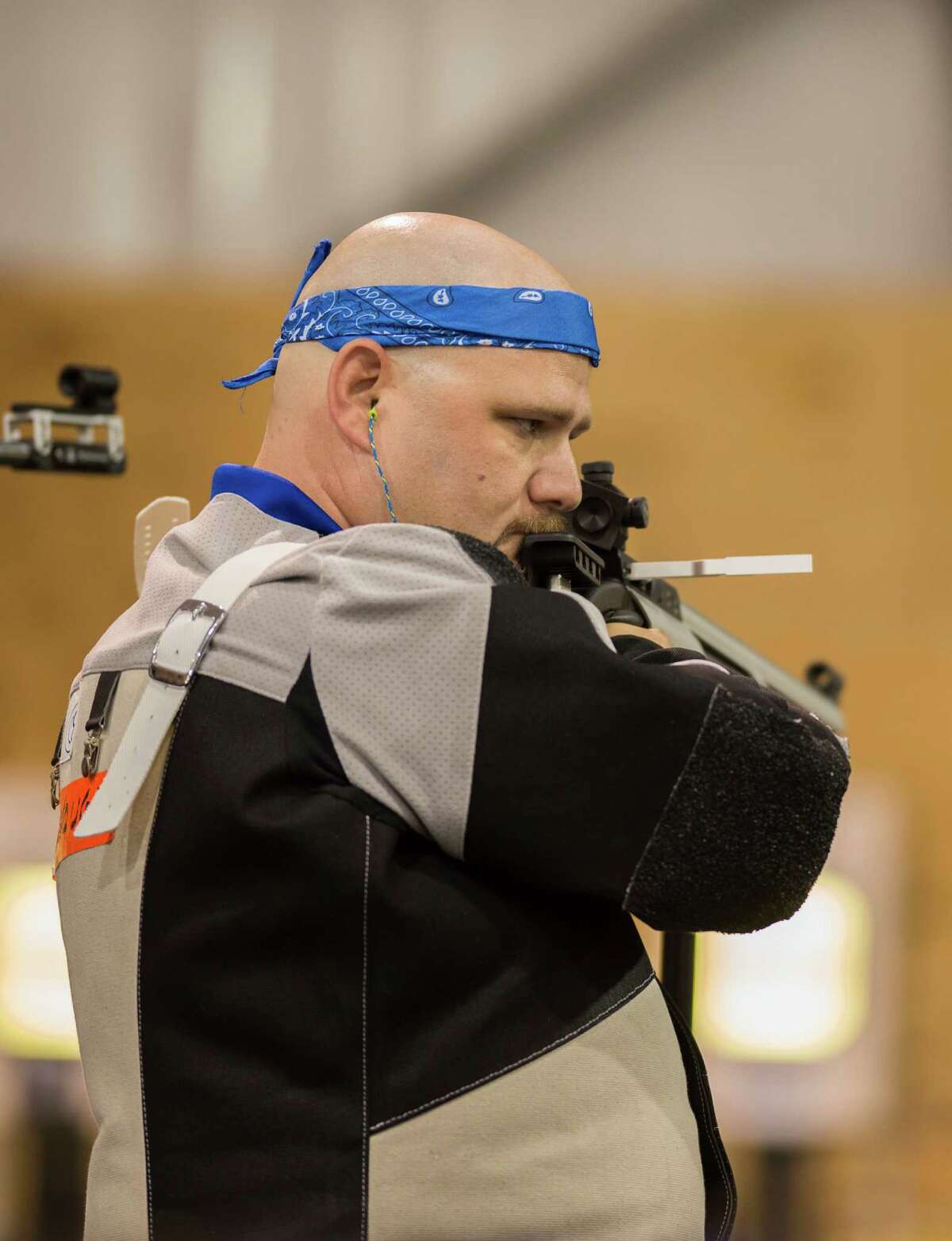 Retired U.S. Air Force Tech Sgt. Timothy McDonough prepares to sight in at the 2015 Department of Defense (DoD) Warrior Games shooting competition at Lejeune Field, Quantico, Va., June 26, 2015. The Warrior Games, founded in 2010, is a Paralympic-style competition that features eight adaptive sports for wounded, ill, and injured service members and veterans from the U.S. Army, Marine Corps, Navy/Coast Guard, Air Force, Special Operations Command, and the British Armed Forces. This year marks the first time the DoD takes responsibility for operational planning and coordination of the event, in which approximately 250 athletes are expected to compete. (U.S. Marine Corps photo by Lance Cpl. Timothy A. Turner/Released)