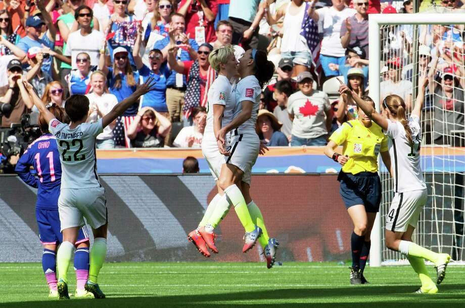 United States' Lauren Holiday, center right, Megan Rapinoe, center left, Meghan Klingenberg (22) and Morgan Brian (14) celebrate Holiday's goal against Japan during first half action in the FIFA Women's World Cup soccer soccer championship in Vancouver, British Columbia, Canada, Sunday, July 5, 2015.   (Jonathan Hayward/The Canadian Press via AP) MANDATORY CREDIT Photo: JONATHAN HAYWARD, Associated Press / CP