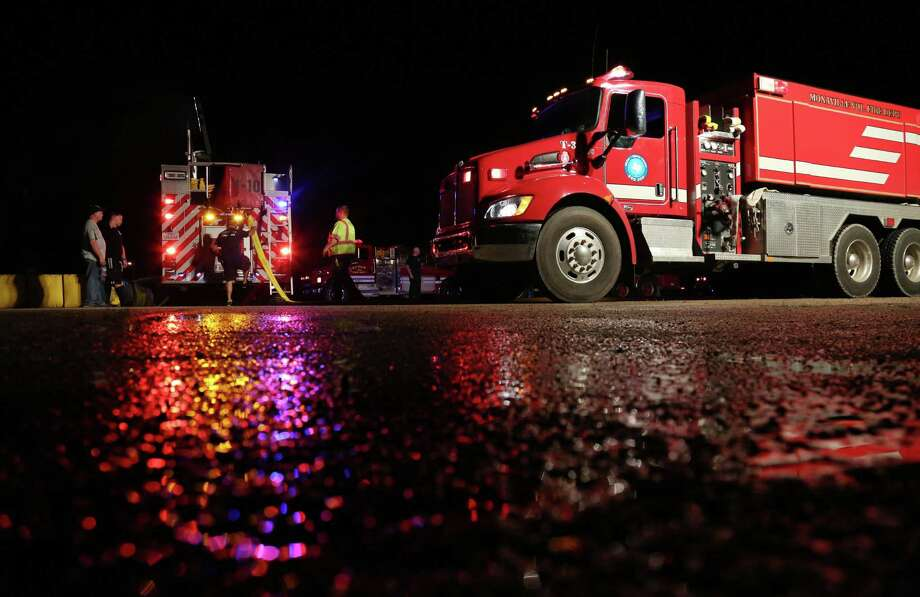 Firefighters set up a water staging area while responding to a fire at a Flowchem plant late Saturday night in Waller County northwest of Houston. Twelve fire departments responded to the blaze, which was extinguished by 2:30 a.m. Photo: Jon Shapley, Staff / © 2015 Houston Chronicle