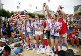 (left to right) Loren Robinow, Savannah Irwin, Rebecca Phelan, Emily Kaleal, Holly Gallagher, Serena Valerio and Barbara Phelan, all of Concord, celebrates a USA goal during a Women's World Cup viewing party in San Francisco, Calif., on Sunday, July 5, 2015.