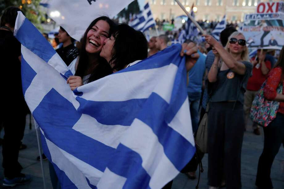 Supporters of the No vote celebrate Sunday in Syntagma Square in Athens, after  Greeks spurned a European-led bailout deal for their ailing economy. Photo: Petros Giannakouris, STF / AP
