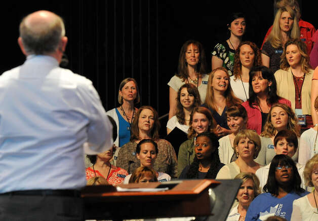 Local Teens Join Famed Choir Local choral students from Burnt Hills/Ballston Lake, Schoharie and Queensbury got a once in a lifetime chance to sing with the world renowned Mormon Tabernacle Choir during their sound check rehearsal June 29 at SPAC. Left of woman in red shirt are (L-R) Allison Tuft and Ashley Fugal of Burnt Hills/Ballston Lake High School. Directly below them are (L-R) Capri VanDerwerken and  Sarah Wright of Schoharie High School.  Jeff Gradon Photo: Picasa