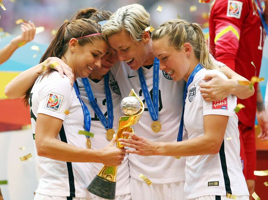 The United States' Alex Morgan, Lauren Holiday, Abby Wambach and Whitney Engen celebrate winning the World Cup following the FIFA Women's World Cup Final match between USA and Japan on Sunday, July 5, 2015, at BC Place Stadium in Vancouver, Canada. Photo: Vaughn Ridley, McClatchy-Tribune News Service