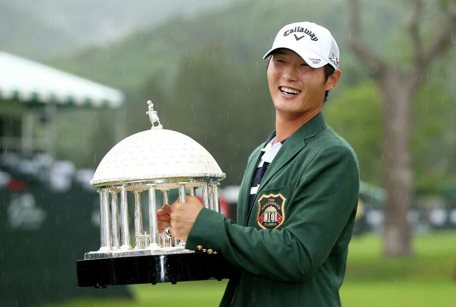 WHITE SULPHUR SPRINGS, WV - JULY 05:  Danny Lee of New Zealand poses with the trophy after winning on the second hole of a sudden death playoff at the Greenbrier Classic held at The Old White TPC on July 5, 2015 in White Sulphur Springs, West Virginia.  (Photo by Darren Carroll/Getty Images) Photo: Darren Carroll, Stringer / 2015 Getty Images