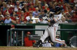 San Francisco Giants' Brandon Crawford  hits a solo home run during the  fourth inning of a baseball game against the Washington Nationals at Nationals Park, Sunday, July 5, 2015, in Washington. (AP Photo/Alex Brandon)