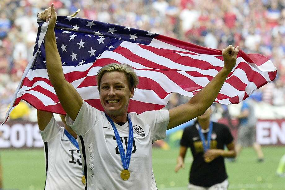 Veteran forward Abby Wambach takes a moment to celebrate with her U.S. teammates after they beat Japan 5-2 on Sunday to win the Women's World Cup.