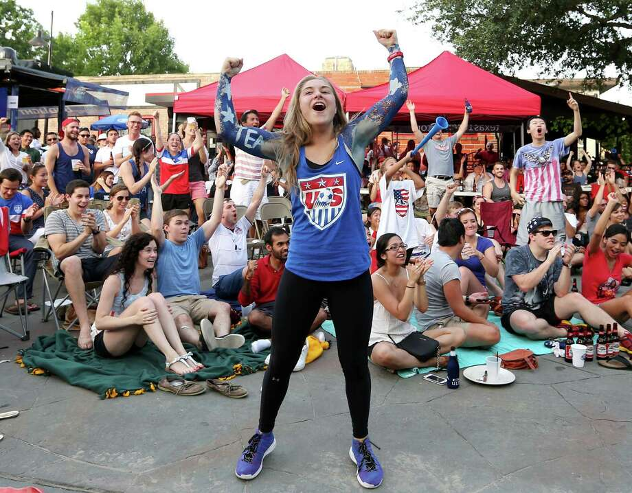 Seleya Tanner and other U.S. soccer fans attending a Sunday watch party at The Phoenix on Westheimer had every reason to party like it was 1999 as the American team won the Women's World Cup for the first time in 16 years. Photo: Jon Shapley, Staff / © 2015 Houston Chronicle