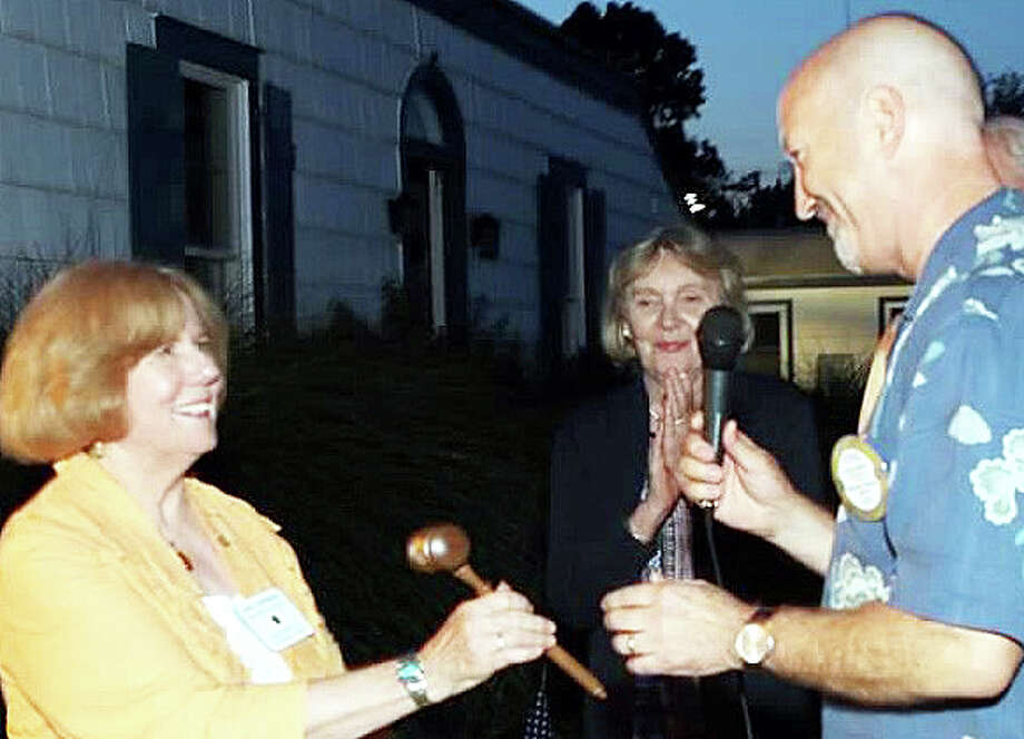 Jane Sherman, left, accepts the gavel as new presdient of the Westport Rotary Club from Steve Lewine, the outgoing president. Photo: Contributed Photo / Contributed Photo / Westport News