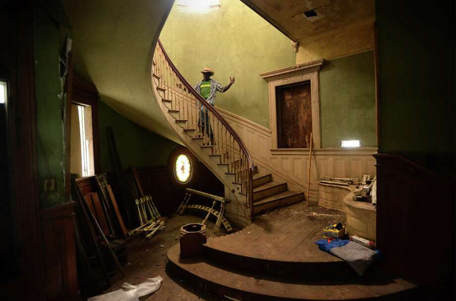 Caretaker Michael Vickers walks up the staircase at the Hinchee House on Beaumont's Park Street Thursday. After decades of dilapidation, the home was recently purchased with restoration plans on the table. The new owner hopes to one day live in the home before giving it to the city as a museum.  Photo taken Thursday, July 02, 2015  Guiseppe Barranco/The Enterprise Photo: Guiseppe Barranco, Photo Editor