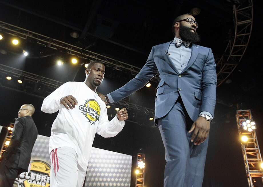 (l-r) Comedian Kevin Hart is led by his coach Houston Rockets guard James Harden during the 2013 Sprint All-Star Celebrity game in the Sprint Arena at the George R. Brown Friday, Feb. 15, 2013, in Houston ( Billy Smith II / Houston Chronicle ) Photo: Houston Chronicle