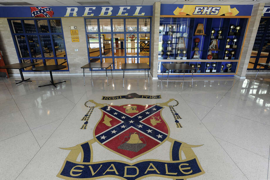 The Evadale High School's coat of arms embedded on the gymnasium's foyer floor. Due to the recent South Carolina shooting, several states and large companies are reconsidering their involvement with the Confederate flag.  Photo taken Wednesday, June 24, 2015  Guiseppe Barranco/The Enterprise Photo: Guiseppe Barranco, Photo Editor