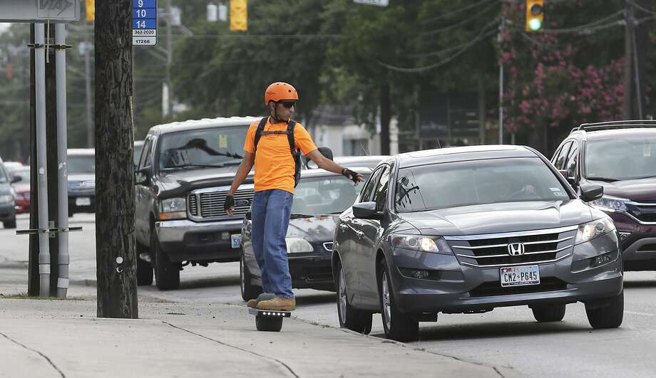 Abstain from riding your One Wheel in traffic-congested lanes. Photo: Tom Reel, San Antonio Express-News