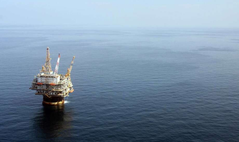 In April, the Bureau of Safety and Environmental Enforcement unveiled proposed requirements for companies to better control offshore wells. Here, a Gulf of Mexico well is shown in 2008. (AP Photo/Mary Altaffer, File) Photo: Mary Altaffer, STF / AP