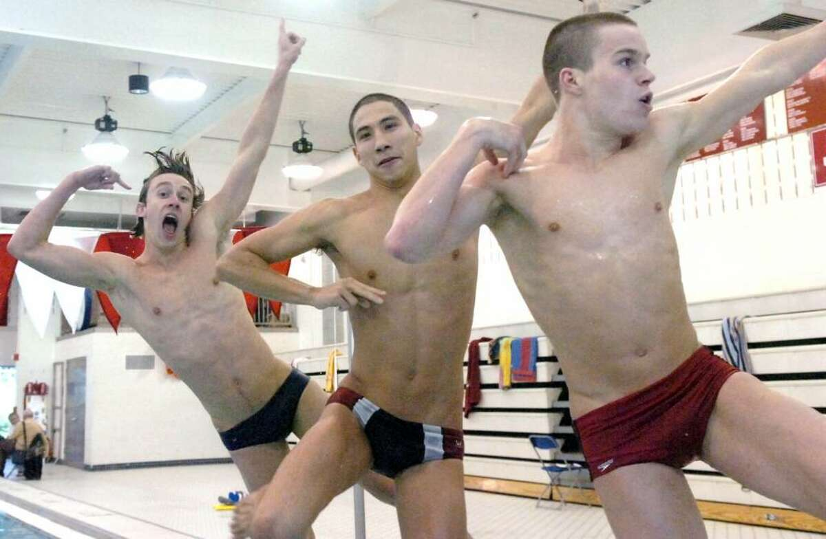 Greenwich High School boys swim team captains from left, Mark O'Connell, Tom Sorenson and Thom Lautenbach leap into the school's pool Tuesday afternoon, March 16, 2010.