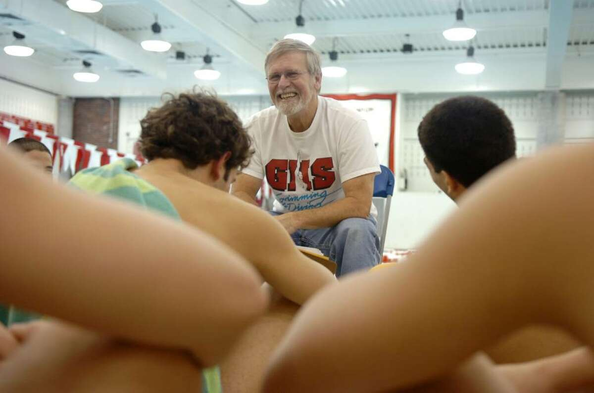 Greenwich High School boys swim team captain Terry Lowe discusses the team's strategy during practice at the school Tuesday afternoon, March 16, 2010.