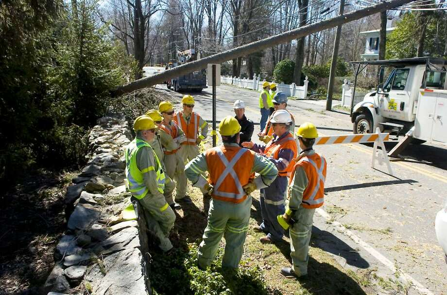 Crews from Hydro Quebec assist CL&P as they restore power along Rings End Road in Darien, Conn. on Tuesday, March 16, 2010. Photo: Kathleen O'Rourke / Stamford Advocate