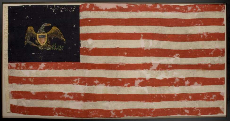 The State Museum will display a recently conserved 19th-century presentation flag reportedly given to the Six Nations Iroquois by the United States government around 1813. (State Museum photo)