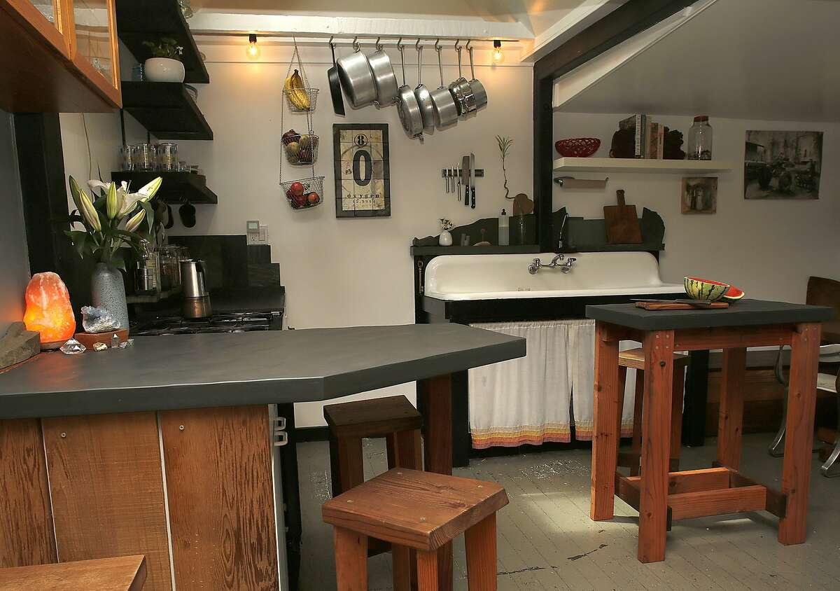 """John Steuernagel custom made the furniture and stone table tops in his kitchen at home in San Francisco, Calif., on Thursday, July 2, 2015. The """"earthquake cottage"""" is one of the few remaining cottages that housed the workers rebuilding SF after the 1906 earthquake."""