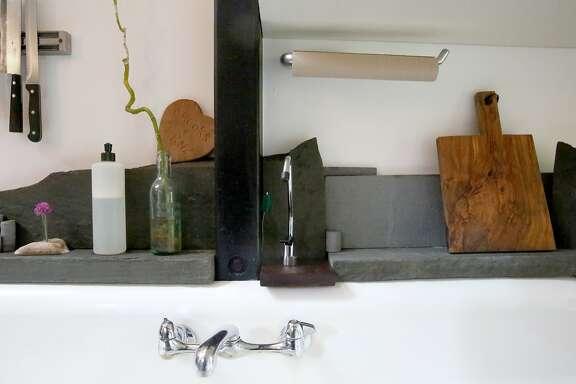 "John Steuernagel made the shelving around the sink in the kitchen of their home in San Francisco, Calif., on Thursday, July 2, 2015.  Their ""earthquake cottage"" is one of the few remaining cottages that housed the workers rebuilding SF after the 1906 earthquake."