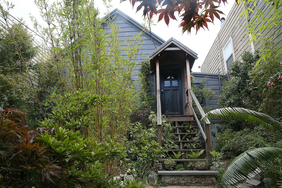"""A view of the front stairway to their home in San Francisco, Calif., on Thursday, July 2, 2015. Their """"earthquake cottage"""" is one of the few remaining cottages that housed the workers rebuilding SF after the 1906 earthquake."""