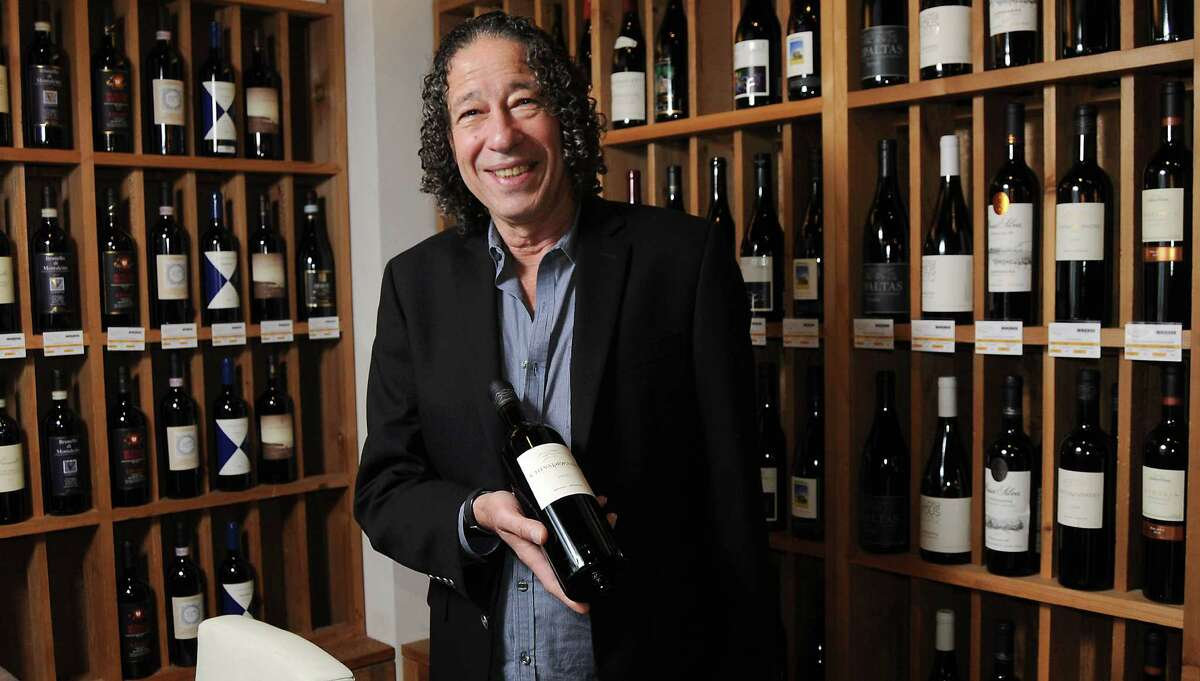 Beckrew's sommelier Virgilio Cantu with a bottle of Cheval des Andes 2009 Friday June 25, 2015. (Dave Rossman photo)