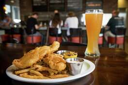 Weisse Versa fish and chips, with a glass of Weisse Versa beer, is shown at Karbach Brewing Co., on Tuesday, June 23, 2015, in Houston. ( Brett Coomer / Houston Chronicle )