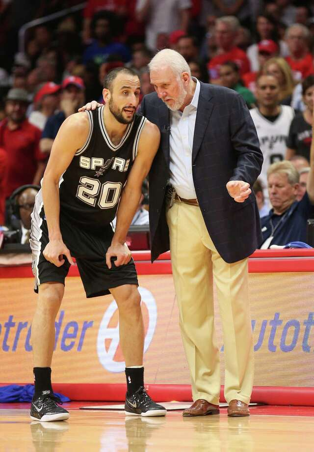 Head coach Gregg Popovich and Manu Ginobili of the San Antonio Spurs confer as they play the Los Angeles Clippers during Game 5 of the Western Conference quarterfinals of the 2015 NBA playoffs at Staples Center on April 28, 2015, in Los Angeles, California. The Spurs won 111-107. Photo: Stephen Dunn /Getty Images / 2015 Getty Images