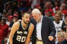 Head coach Gregg Popovich and Manu Ginobili of the San Antonio Spurs confer as they play the Los Angeles Clippers during Game 5 of the Western Conference quarterfinals of the 2015 NBA playoffs at Staples Center on April 28, 2015, in Los Angeles, California. The Spurs won 111-107.