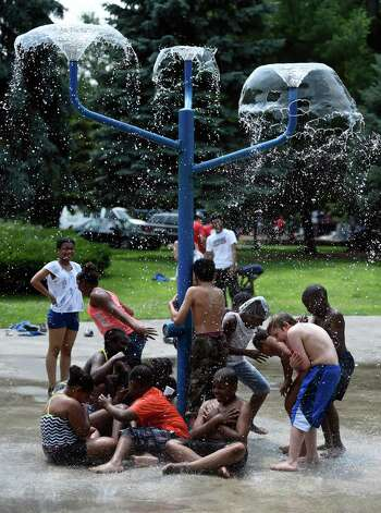 A group of campers from Pastor Charlie's Hip Hop Hope Camp enjoy the cooling waters of the Swinburne Park Spray Pool Monday afternoon July 6, 2015 in Albany, N.Y.  The Hip Hop Hope Camp will run daily through the end of August and is free for children ages 5-12.  There are several locations where Pastor Charlie's Trolly pick up the children and transport them to Swinburne Park in Albany.    (Skip Dickstein/Times Union) Photo: SKIP DICKSTEIN