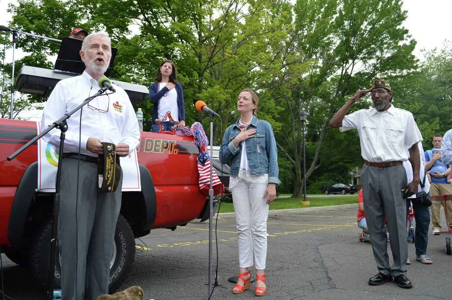 "Phil Kraft, commander of local VFW 6933, left, leads the singing of ""America,"" helped by Emily Hall and Dennis Clayburn. Photo by Jarret Liotta. Photo: Contributed /Jaret Liotta / Darien News"