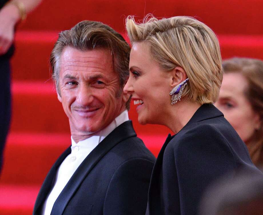 "Sean Penn and Charlize Theron during happier times. At the ""Charles James: Beyond Fashion"" Costume Institute Gala at the Metropolitan Museum of Art on May 5, 2014 in New York City. Photo: James Devaney, Contributor / 2014 James Devaney"