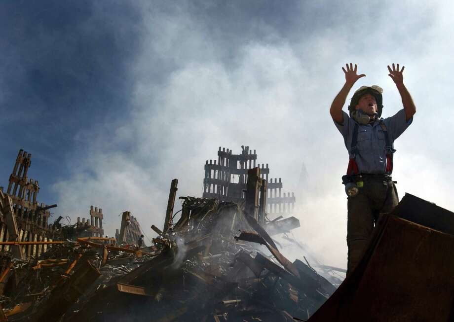 A New York City fireman calls for 10 more rescue workers to make their way into the rubble of the World Trade Center in 2001. Photo: National Geographic Channels, U.S. Navy Photo / public domain