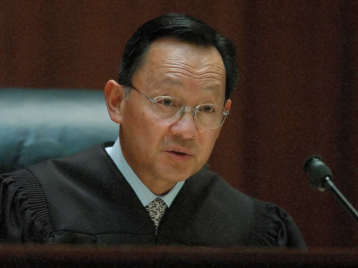 California Supreme Court Justice Ming Chin speaks in a San Francisco courtroom in this May 25, 2004, photo. Justice Chin, recovering from January 2006, skull surgery, will be sidelined from taking the bench during oral arguments for what will be the third month in a row when the justices begin holding public sessions in San Francisco Tuesday, March 7, 2006. While the timing of the 63-year-old Chin's return to the public spotlight is uncertain, his absence from the bench is delaying cases and at times causing lower court judges to fill the vacuum. (AP Photo/Paul Sakuma)