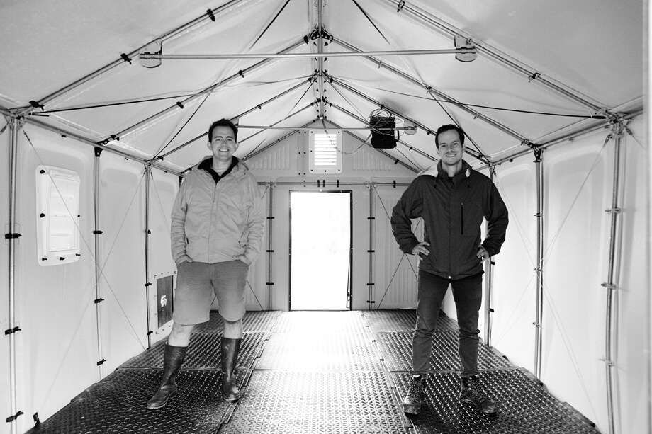 Scott Key and Sam Brisendine in a shelter with Emergency Floor. Photo: Good Works Studios