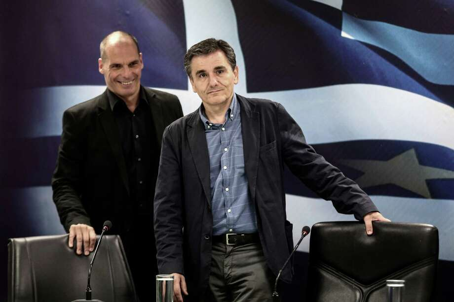 Euclid Tsakalotos (front) was appointed Greece's finance minister after Yanis Varoufakis (back) resigned. Photo: Yorgos Karahalis /Bloomberg / © 2015 Bloomberg Finance LP