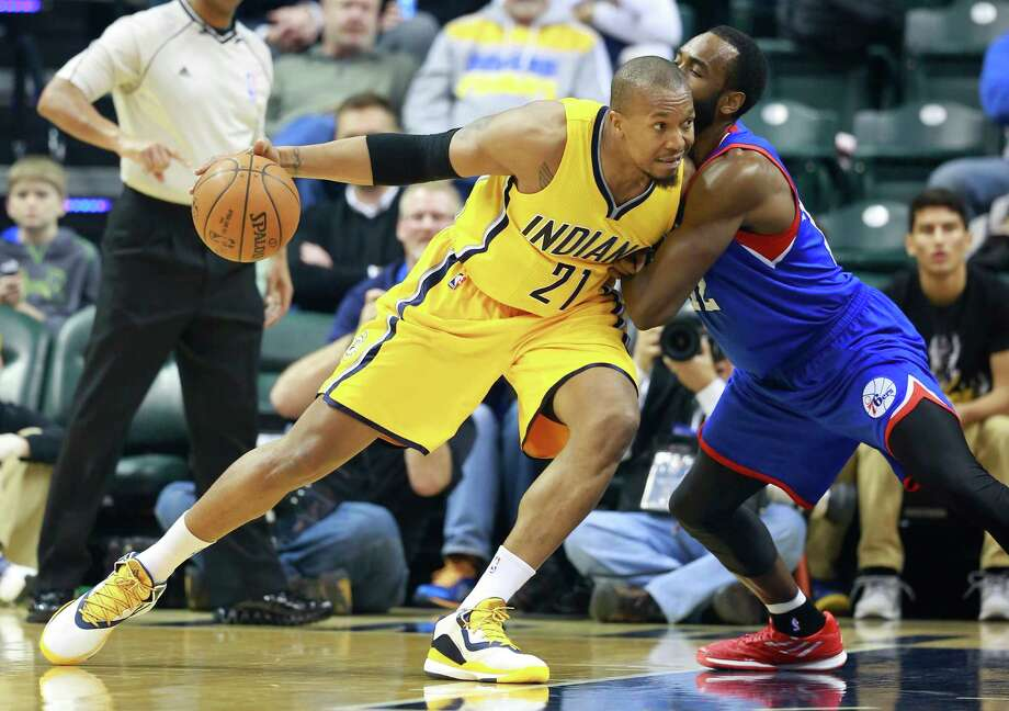 Indiana Pacers forward David West moves to the basket defended by Philadelphia 76ers forward Luc Mbah a Moute in the first half in Indianapolis on March 1, 2015 Photo: R Brent Smith /Associated Press / FR171017 AP
