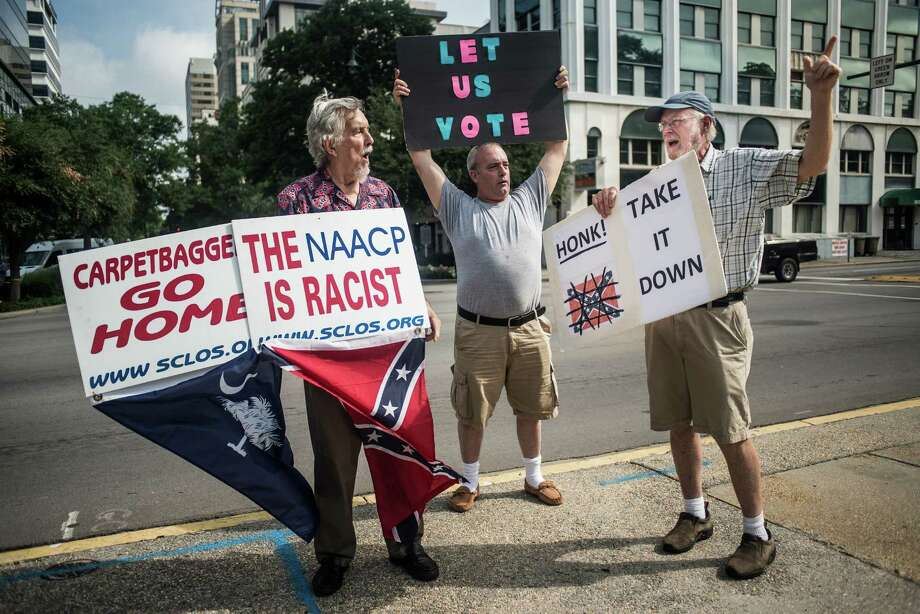 """Robert Hayes (left) calls Tom Clements (right) a """"scallywag"""" as South Carolina senators vote on  a bill to remove the Confederate flag from the grounds of the Statehouse. Photo: Sean Rayford / Getty Images / 2015 Getty Images"""