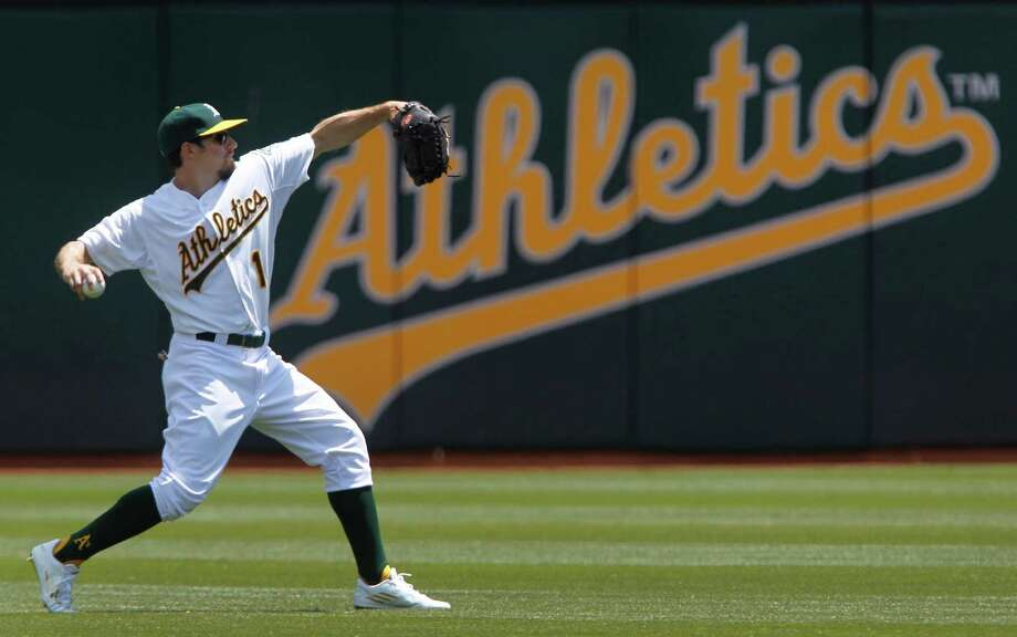 A's center fielder Billy Burns leads all major-league rookies in hits (78) and stolen bases (17) despite spending much of April in the minors. Photo: Paul Chinn / The Chronicle / ONLINE_YES