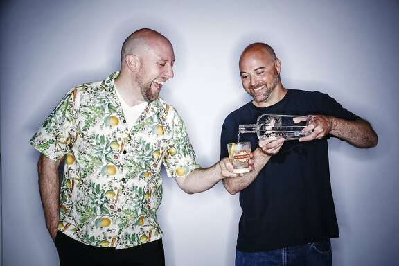Martin Cate, left, and Alex Smith, seen Monday, July 6, 2015 in San Francisco, Calif., are teaming up to open Whitechapel, a gin-centered bar, later this year.