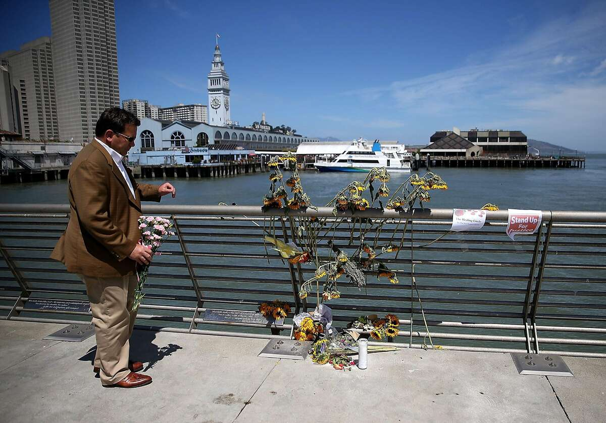 SAN FRANCISCO, CA - JULY 06: A well-wisher drops off flowers at the site where 32-year-old Kathryn Steinle was killed on July 6, 2015 in San Francisco, California. According to police, Steinle was shot and killed by Francisco Sanchez as she walked with her father on San Francisco's Pier 14 on July 1. Sanchez had been previously deported five times. (Photo by Justin Sullivan/Getty Images)