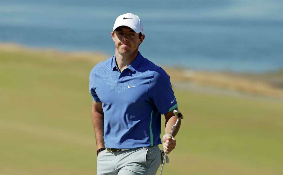Rory McIlroy, of Northern Ireland, smiles after a birdie on the second hole during the third round of the U.S. Open golf tournament at Chambers Bay on Saturday, June 20, 2015 in University Place, Wash. (AP Photo/Charlie Riedel) Photo: Charlie Riedel, STF / AP