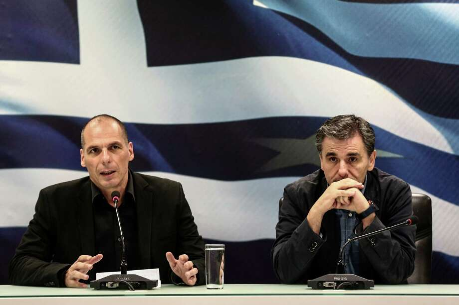 Yanis Varoufakis, left, has been replaced as Greece's finance minister by Euclid Tsakalotos, right, a 55-year-old economist who appears more willing to engage with creditors. Photo: Yorgos Karahalis / © 2015 Bloomberg Finance LP