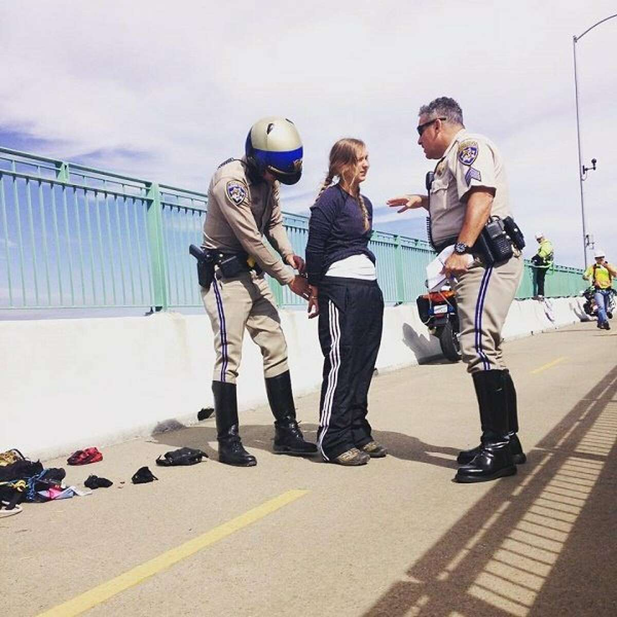 Emily Heffling, of Oakland, is arrested by officers on the Benicia-Martinez railroad bridge on July 6, 2015.