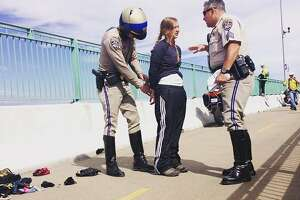 4 arrested after midair oil-train protest at Benicia Bridge - Photo