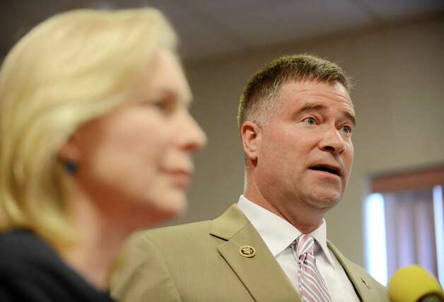 Sen. Kirsten Gillibrand and Rep. Chris Gibson speak during a press conference where they called for passage of legislation that would include veterans who served in the waters surrounding Vietnam among a group presumed to have been exposed to Agent Orange. They spoke on Monday, July 6, 2015, at the Joseph E. Zaloga American Legion Post 1520 in Colonie, N.Y. (Will Waldron/Times Union) Photo: WW / 00032505A