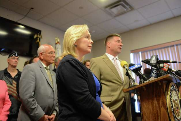 Sen. Kirsten Gillibrand, center, Rep. Paul Tonko, left, and Rep. Chris Gibson, right, speak during a press conference where they called for passage of legislation that would include veterans who served in the waters surrounding Vietnam among a group presumed to have been exposed to Agent Orange. They spoke on Monday, July 6, 2015, at the Joseph E. Zaloga American Legion Post 1520 in Colonie, N.Y. (Will Waldron/Times Union) Photo: WW / 00032505A