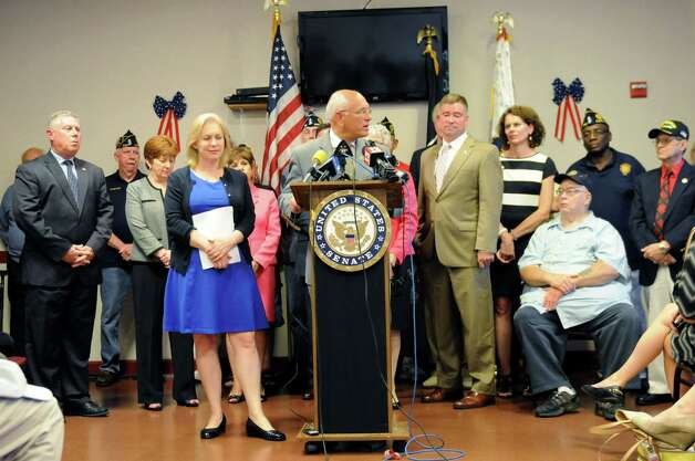 Rep. Paul Tonko, center, speaks during a press conference where Sen. Kirsten Gillibrand, center left, and Rep. Chris Gibson, center right, called for passage of legislation that would include veterans who served in the waters surrounding Vietnam among a group presumed to have been exposed to Agent Orange. They spoke on Monday, July 6, 2015, at the Joseph E. Zaloga American Legion Post 1520 in Colonie, N.Y. (Will Waldron/Times Union) Photo: WW / 00032505A